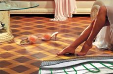 Теплый пол под ламинат: виды, выбор, монтаж